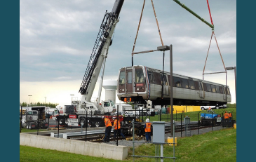 Photo of crane lifting metro car