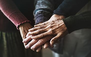 image of a group of seniors hands together