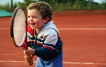 image of child with tennis racket